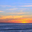 Spectacular sunset over the ocean by Vic Ratnieks