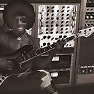 Sly Stone Playing Bass in the Studio by Warren Paul Harris