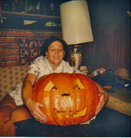 Vickie with a Big Max Pumpkin she raised herself. by Edward Henzi