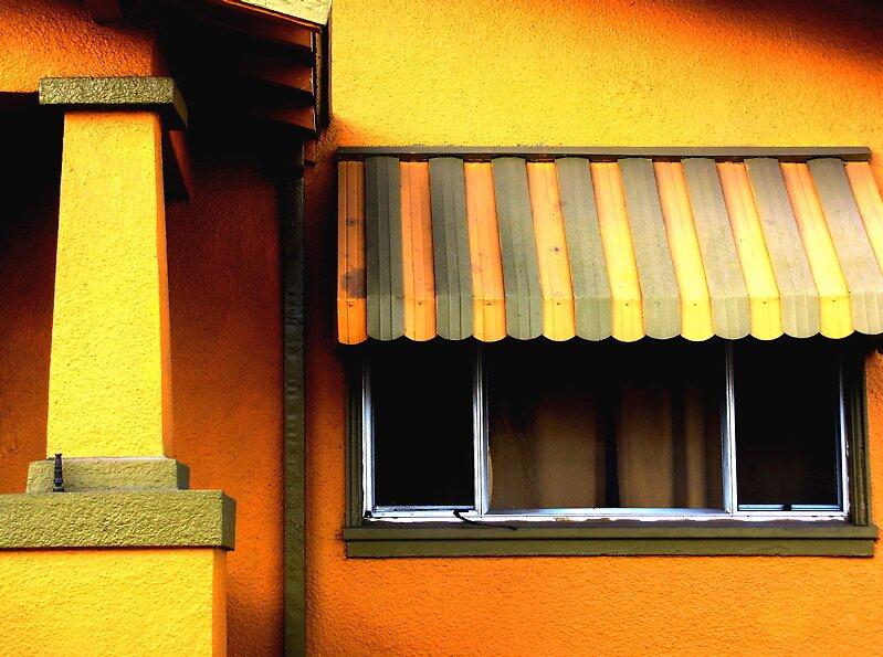yellowish house by Ted Watson