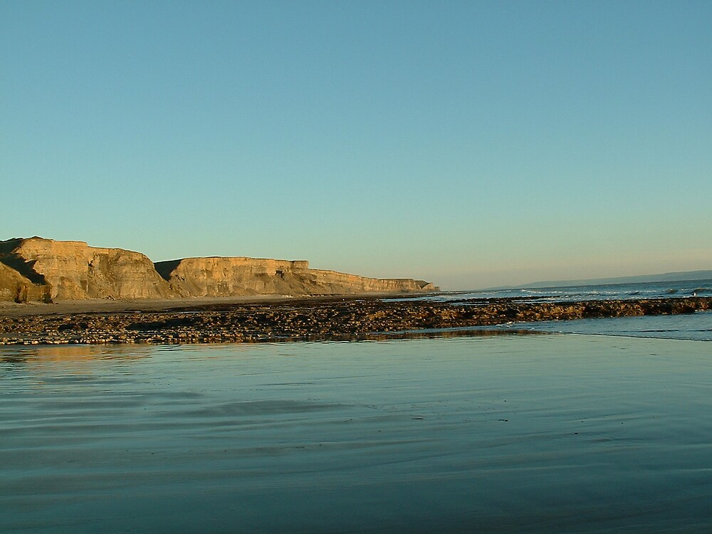 Dunraven cliffs in the distance by MeJude