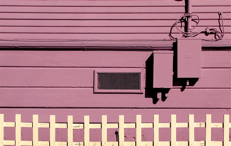purple house, white fence by Ted Watson