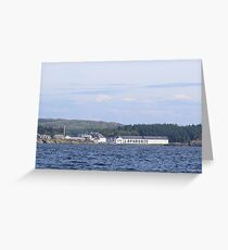 Laphroaig Distillery seen from the ocean under a vast blue sky Greeting Card
