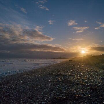 Sunrise on a Pebble Beach by colinsart