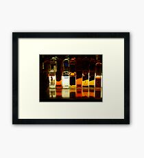 Bottles in a row Framed Print