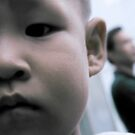 China Boy and Father in Background by eyesoftheeast