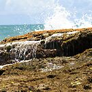 sea wave crashing the rocks by momarch