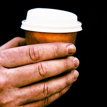 Small coffee cup in man's hand. by artistrobd