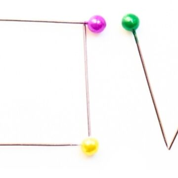 Colorful straight pins as a love sign by igorsin