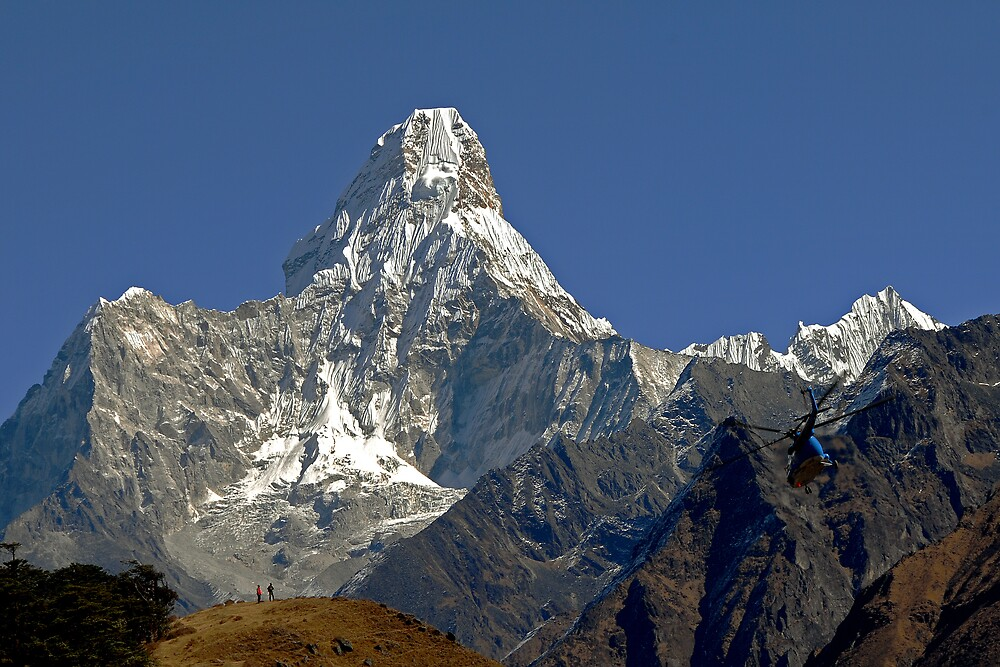 Ama Dablam and rescue helicopter above Namche Bazaar by Richard  Stanley