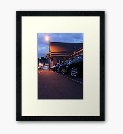 Sodium light at the car lot Framed Print