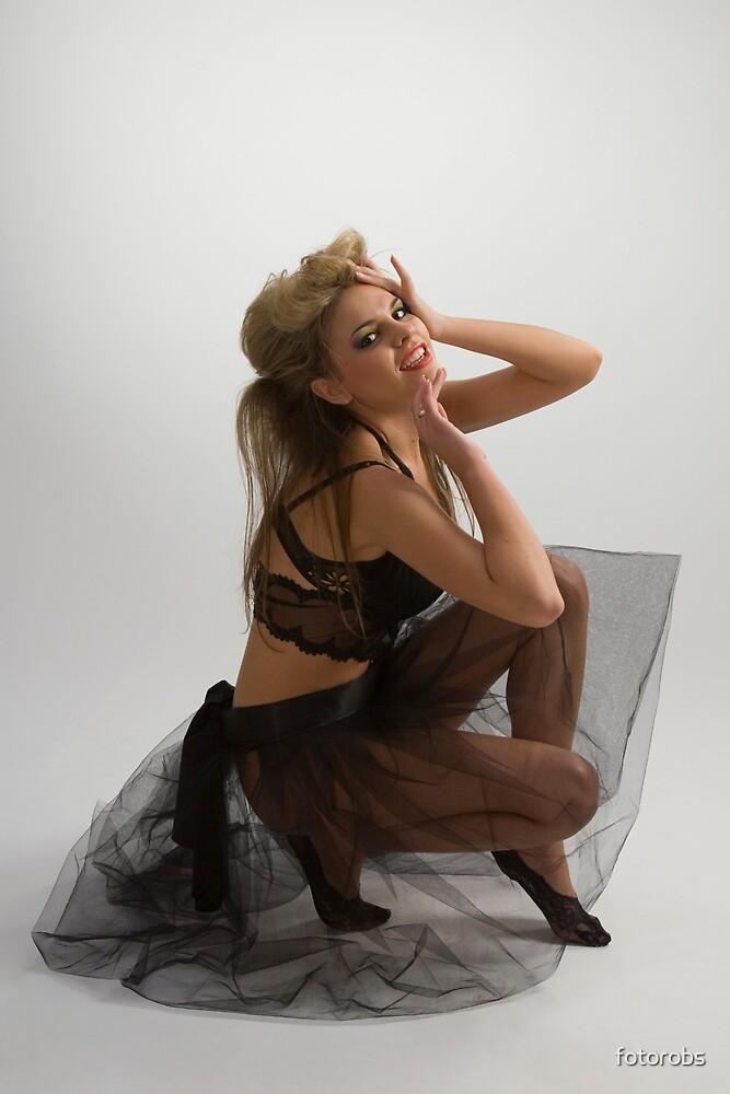 Beautiful girl in diaphanous skirt by fotorobs