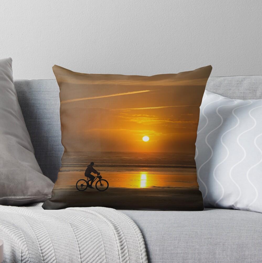 Silhouette of a cyclist along Cannon Beach Oregon Throw Pillow