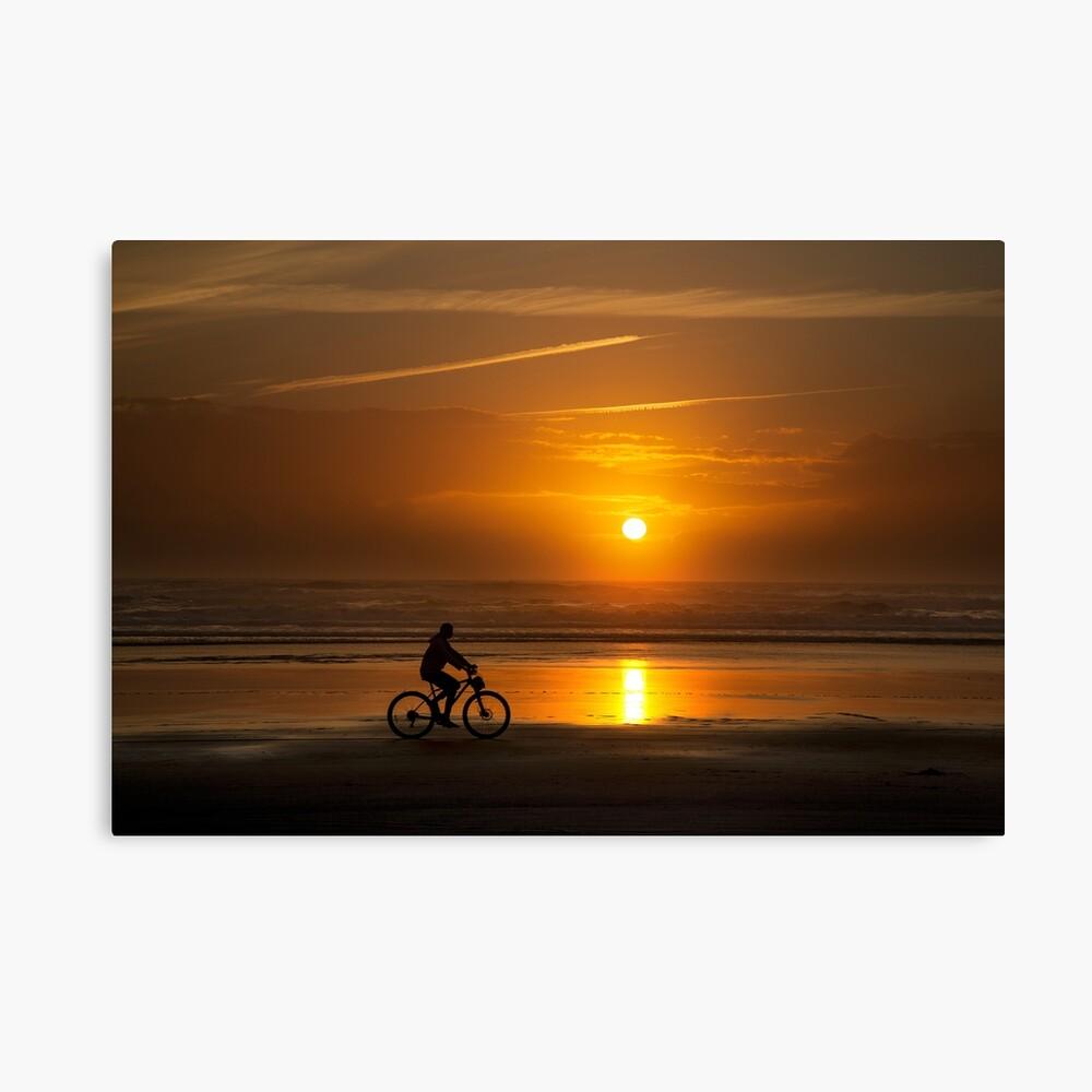 Silhouette of a cyclist along Cannon Beach Oregon Canvas Print