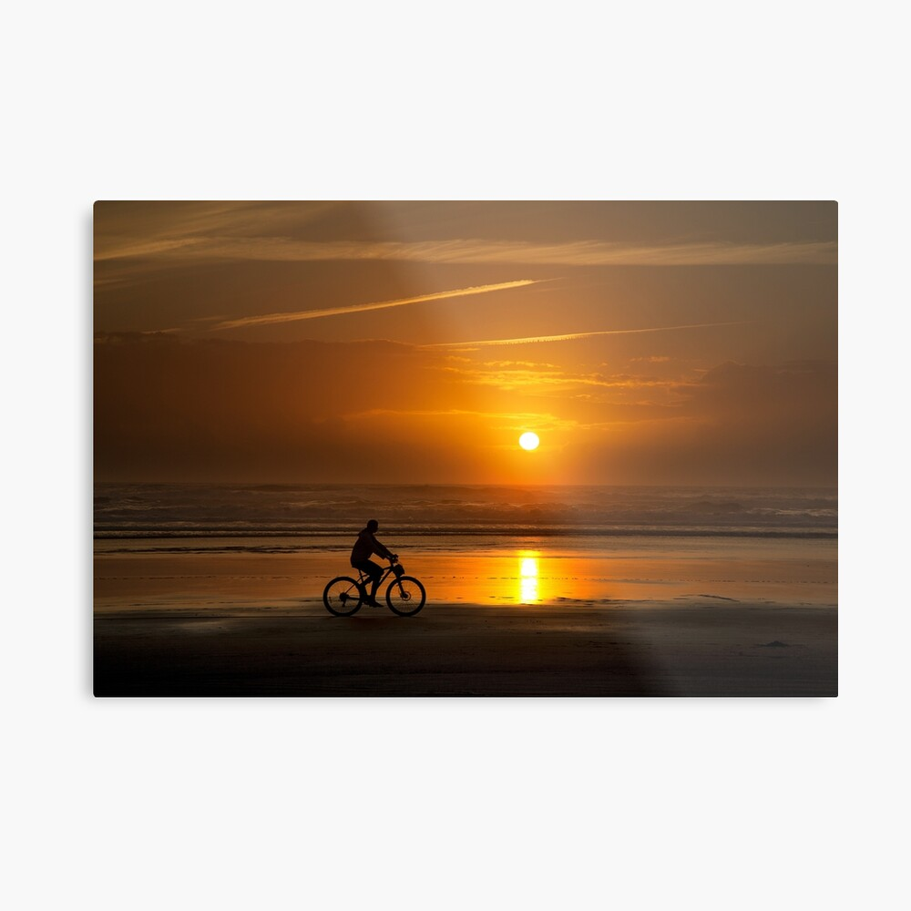 Silhouette of a cyclist along Cannon Beach Oregon Metal Print
