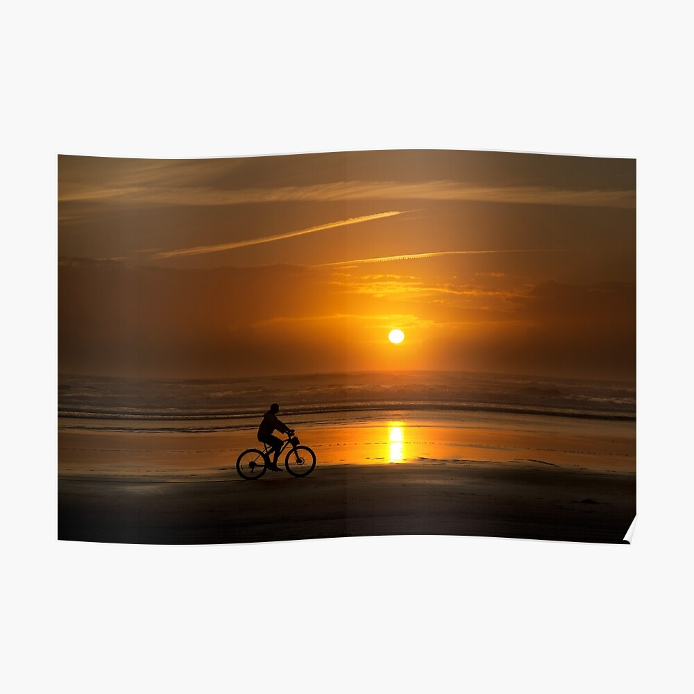 Silhouette of a cyclist along Cannon Beach Oregon Poster