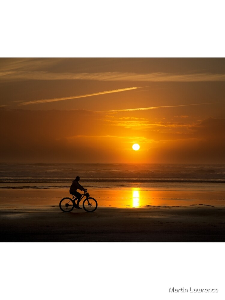 Silhouette of a cyclist along Cannon Beach Oregon by MartinLawPhoto