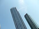 Tall buildings in the blue sky by amak