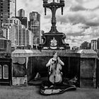 Musician on the Bridge by Bette Devine