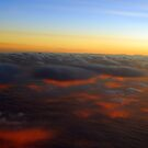 Sunset To My Back At 37,000 ft by Irvin Le Blanc
