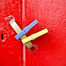 Red Clothespin Door by phil decocco