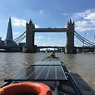 Narrowboat approaching Tower Bridge on the River Thames in London by CruisingTheCut