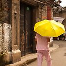 Woman with yellow umbrella  by mistyrose