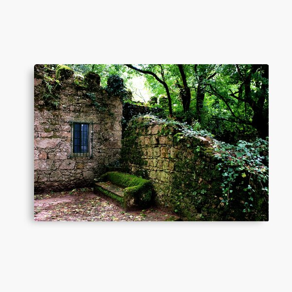 A bench in the shadow of the Moorish Castle Canvas Print