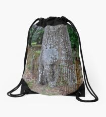 Tree liked the fence just where it was! Drawstring Bag