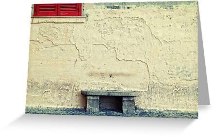 Stone bench, closed shutters and graffiti by Silvia Ganora