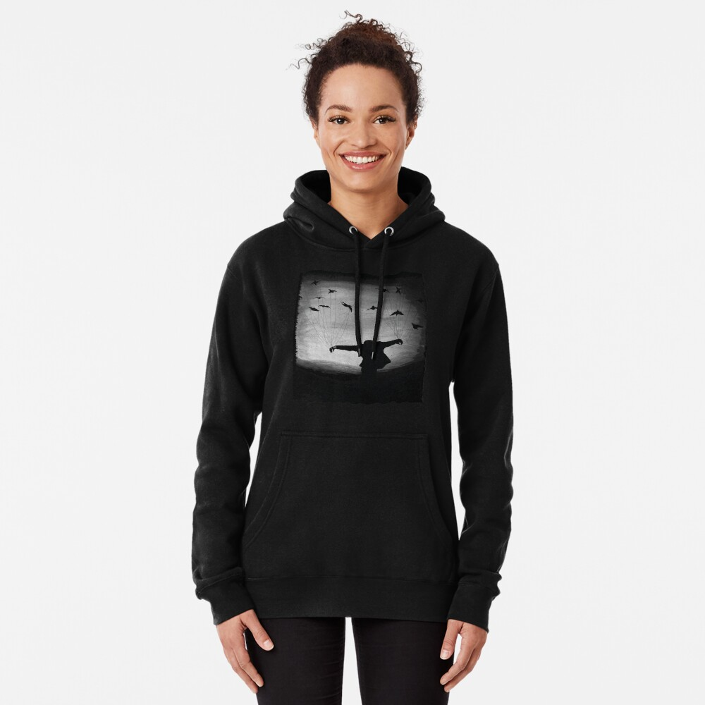 Man In flight with ravens Pullover Hoodie