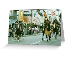 Equestrians canter on their mounts while avoiding spectators. Greeting Card