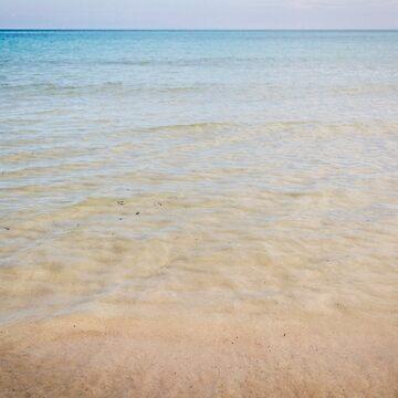 Crystal clear water on sandy beach by sunilbhar