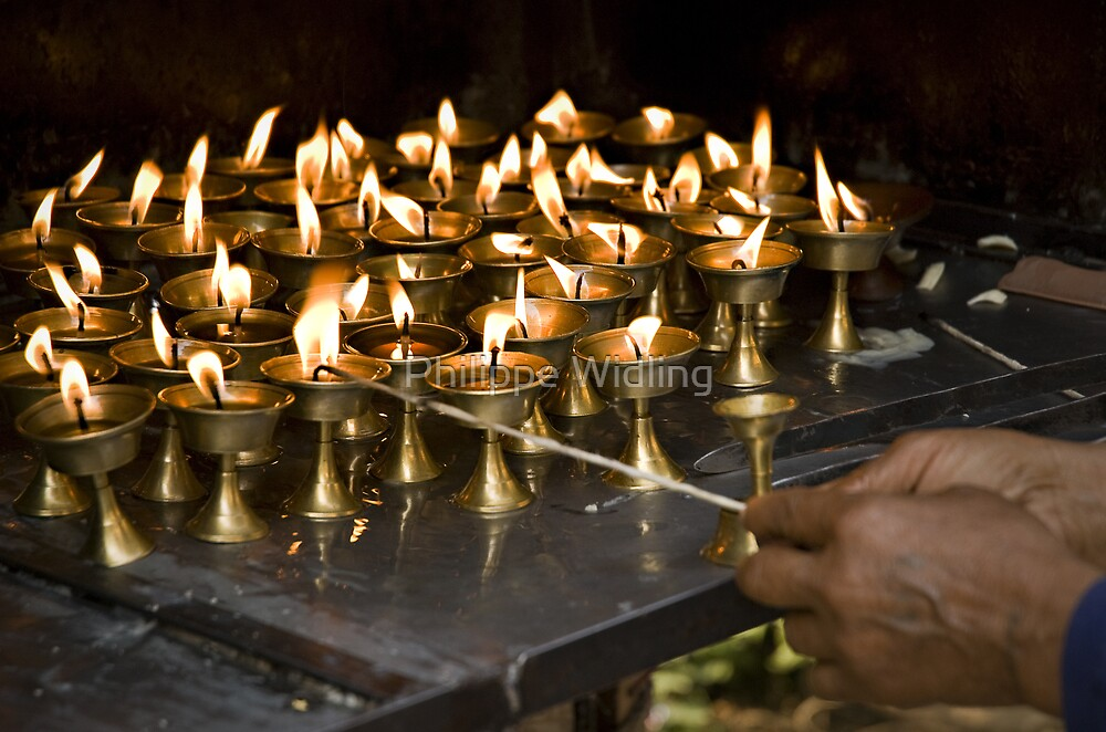 Hand lighting butter lamps. by Philippe Widling