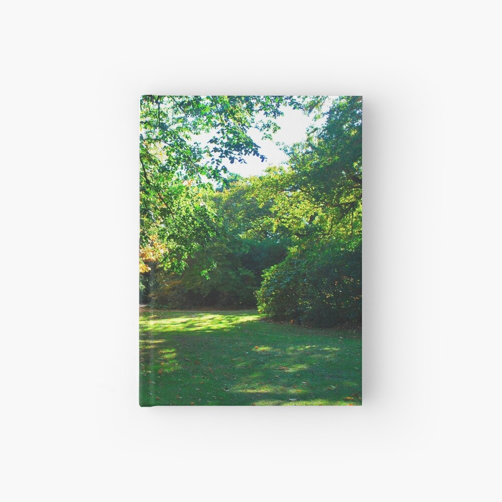 Garden with shades of light in autumn fall Hardcover Journal