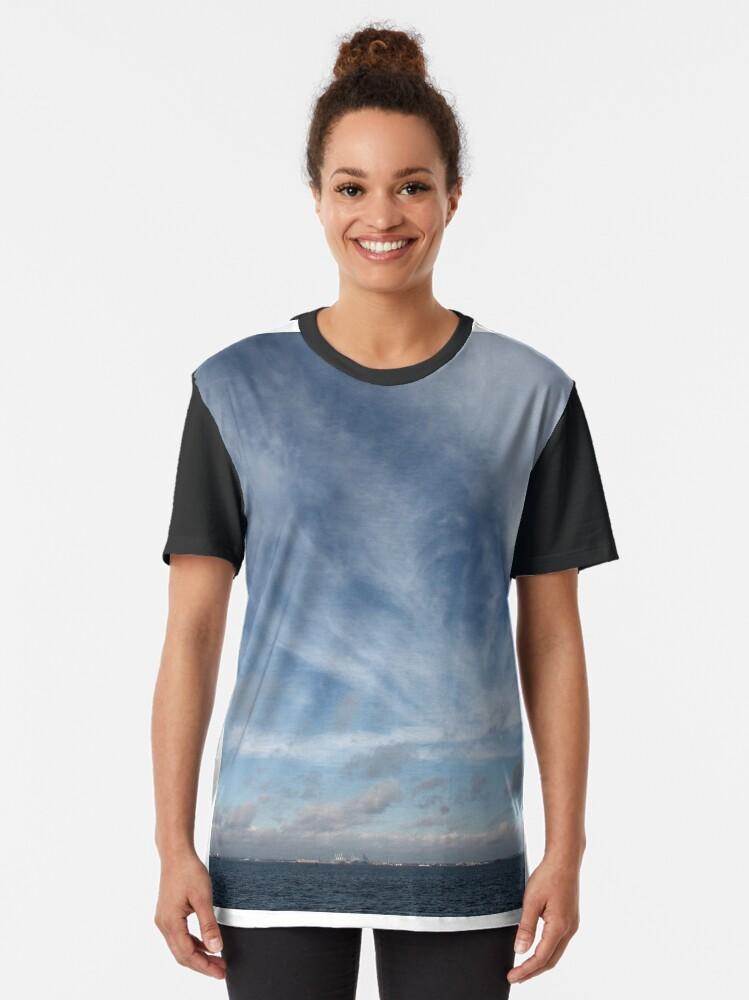 Alternate view of #sky #landscape #nature #outdoors #weather #storm #water #sea #rain #sunset #summer #horizontal #blue #colorimage #wide #nopeople #day #lightnaturalphenomenon #scenicsnature #sun #cloudsky #coastline Graphic T-Shirt
