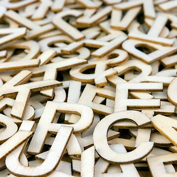 Pile of Mixed Wooden Letters Close Up by MarkUK97