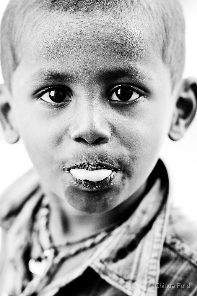 Gypsy Boy with tounge out by Chinua Ford