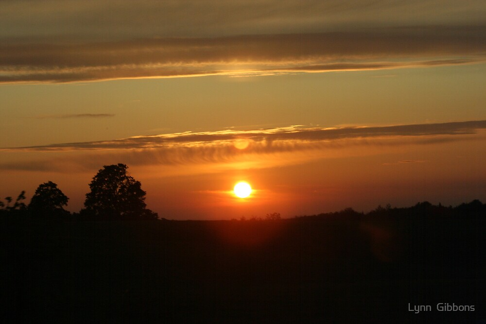Sunset and the Suns Reflection by Lynn  Gibbons