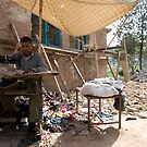 Seamstress in the streets of Kathmandu, Nepal by Yves Roumazeilles