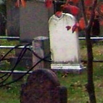 Ghostly Little Boy against a pole at the Sleepy Hollow Cemetery by amberwayne52