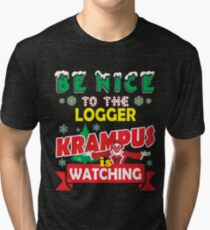 Be Nice To The Logger Krampus Is Watching Funny Xmas Design Tri-blend T-Shirt