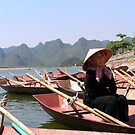 Woman rower waiting for passengers on the Perfume River, Vietnam by Traveldreams