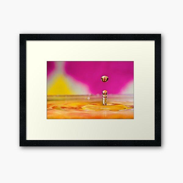 Jumping water drop Framed Art Print