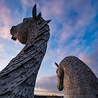 Kelpies admire the sky - Falkirk Scotland by Cliff Williams