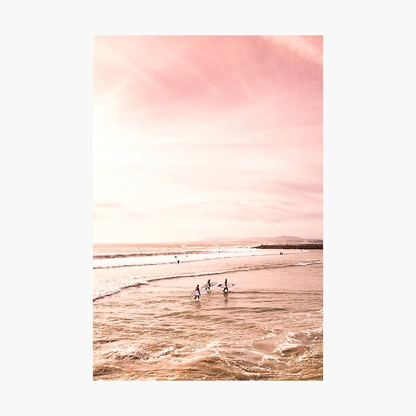 Surfers on beach pink sunset Photographic Print
