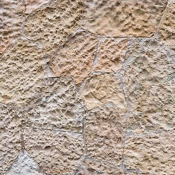 Brown wall of stone blocks of irregular shape and uneven surface for use as a background close up by vladromensky
