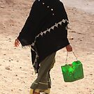 Zagora (Morocco) - woman with bucket by Christine Oakley