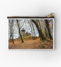 medieval fortress in autumn leafless forest Studio Pouch