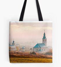 catholic and orthodox churches at foggy sunrise Tote Bag